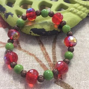 Green red and copper tone beaded stretch bracelet